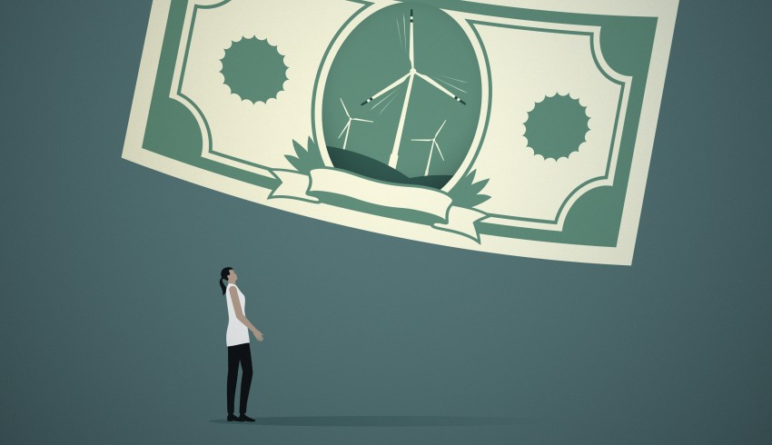 Woman looking at wind turbines on banknote