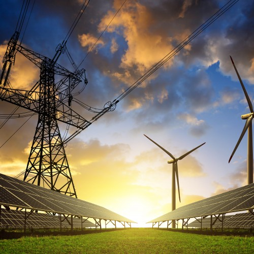 Photo of power lines, solar panels and wind turbines